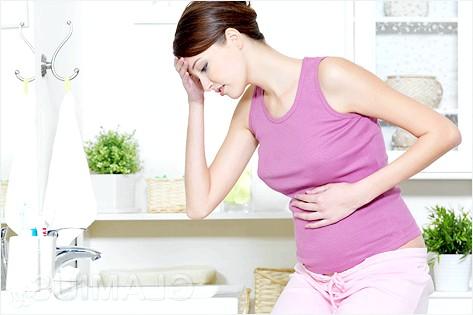 Чому болить живіт при вагітності