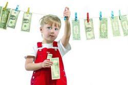 Як навчити дитину поводитися з грошима